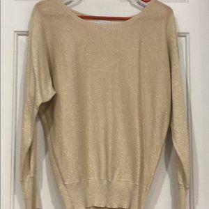 Long gold sweater